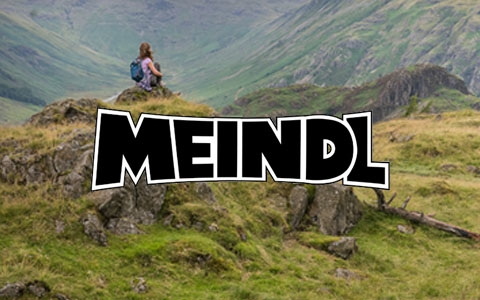 Man walking down a mountain in Meindl footwear.