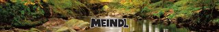 A view of some water surrounded by rocks, stones, and plants with Meindl brand logo in the middle.