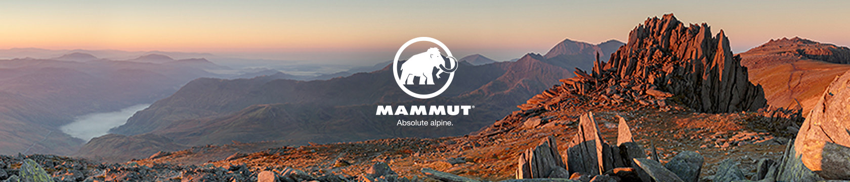 People running through a cave wearing mammut