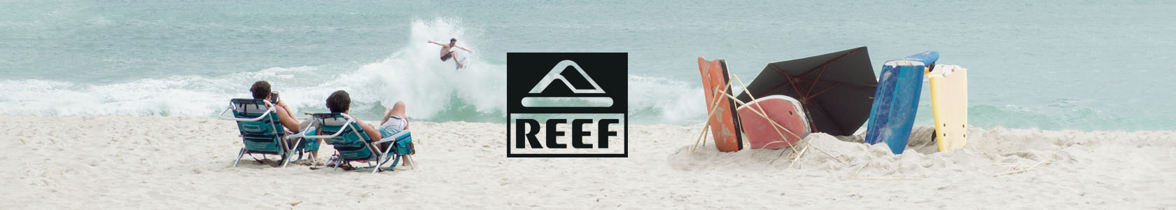 Surfer riding wave wearing Reef gear.