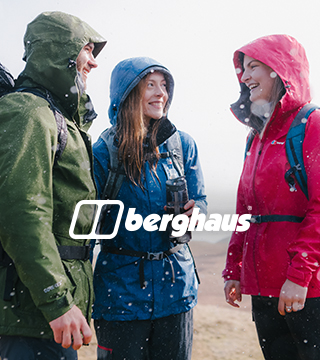 Three people wearing Berghaus backpacks and jackets under the rain