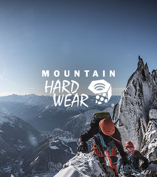 Two people climbing a mountain in Mountain Hardwear gear
