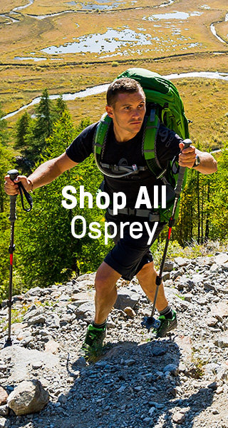 Couple trekking with Osprey backpacks gear.