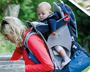 Woman with baby in Osprey child carrier.