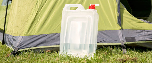 bottle of water against a tent