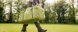 Person carrying vango tent packed up