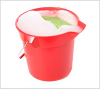 CRed bucket with soapy water