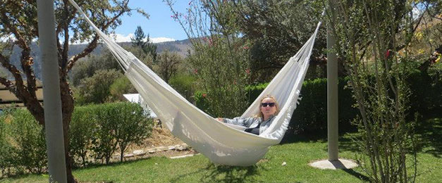 Person in hammock on camping holiday