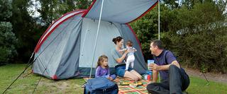 Family outside of a tent