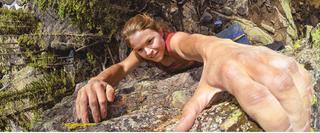 Close up GoPro image from above of woman climbing rock face