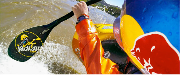 Close up from behind image of kayaker / canoeist paddling at speed