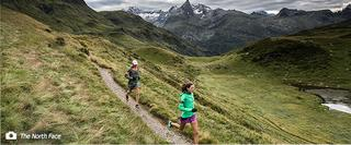2 people trail running among mountains