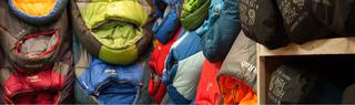 Row of sleeping bags including Rab and Mountain Hardwear