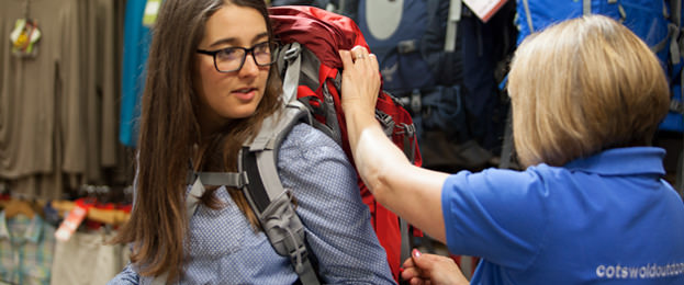 Woman Buying a Rucksack