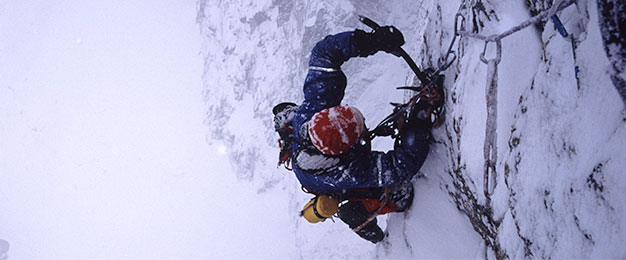 Andy Kirkpatrick climbing snowy cliff face