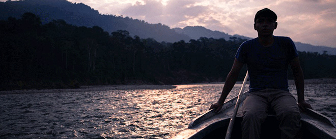Man on Boat with sun setting