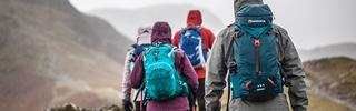 Group walking with rucksacks including Montane & Osprey
