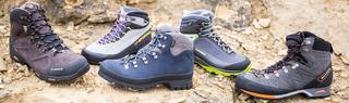 Five walking boots on a rock, including scarpa ranger and treksta