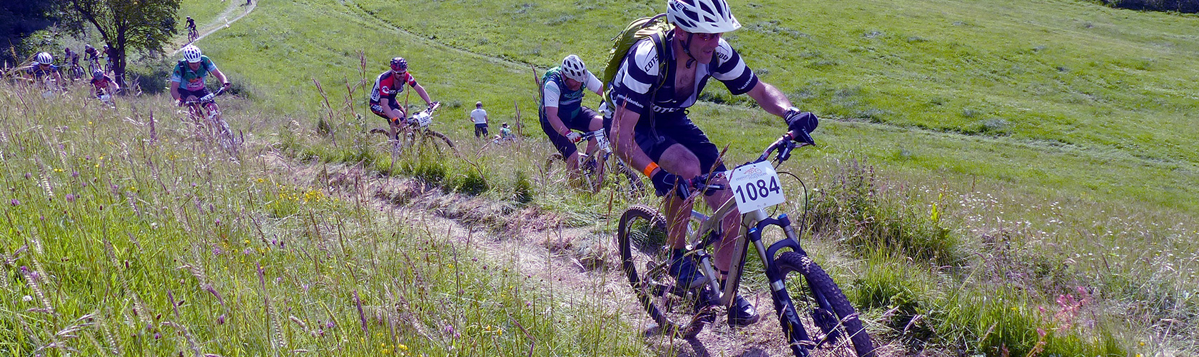 Group of cyclists racing off road