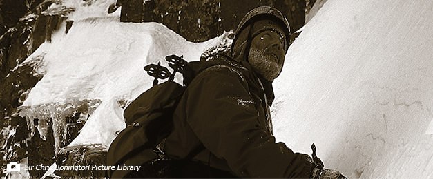 Black and white photograph of Sir Chris Bonington mountaineering